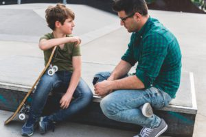 Dad talking to son