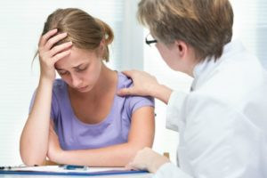 Distraught female patient with counselor