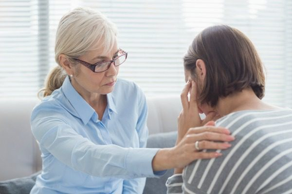 Female therapist with patient