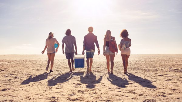 Friends on beach with cooler