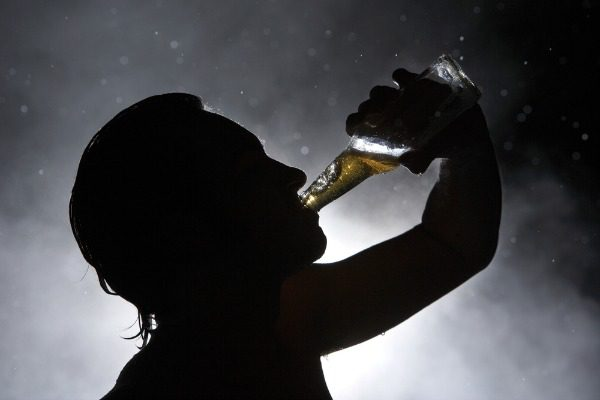 Man chugging beer