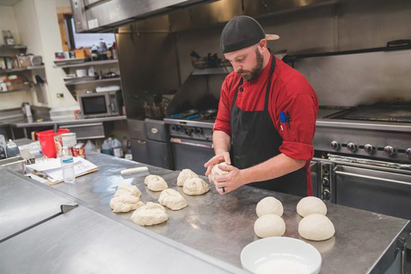 Skywood chef preparing dough for cooking in the kitchen
