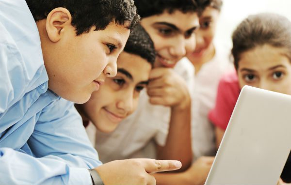 Young students with computer